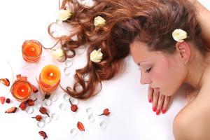 beautiful long-haired girl relaxing in spa salon